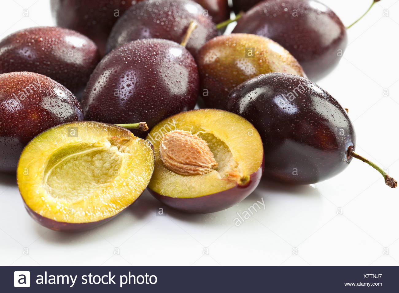 Entire and sliced plums Stock Photo