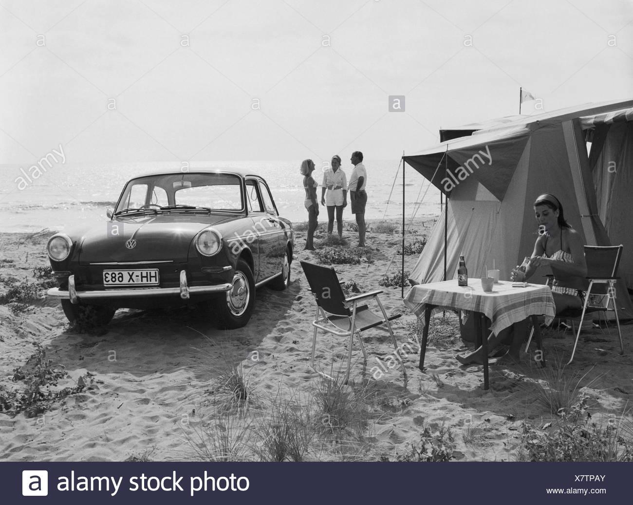 Sandy beach, leisure, tent, car, sea, holidays, - Stock Image