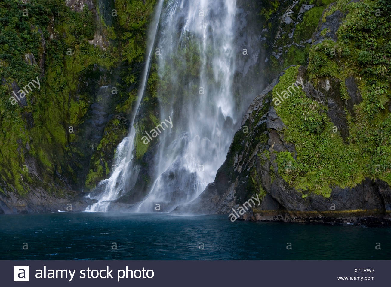Waterfall In Milford Sound Southland South Island New Zealand