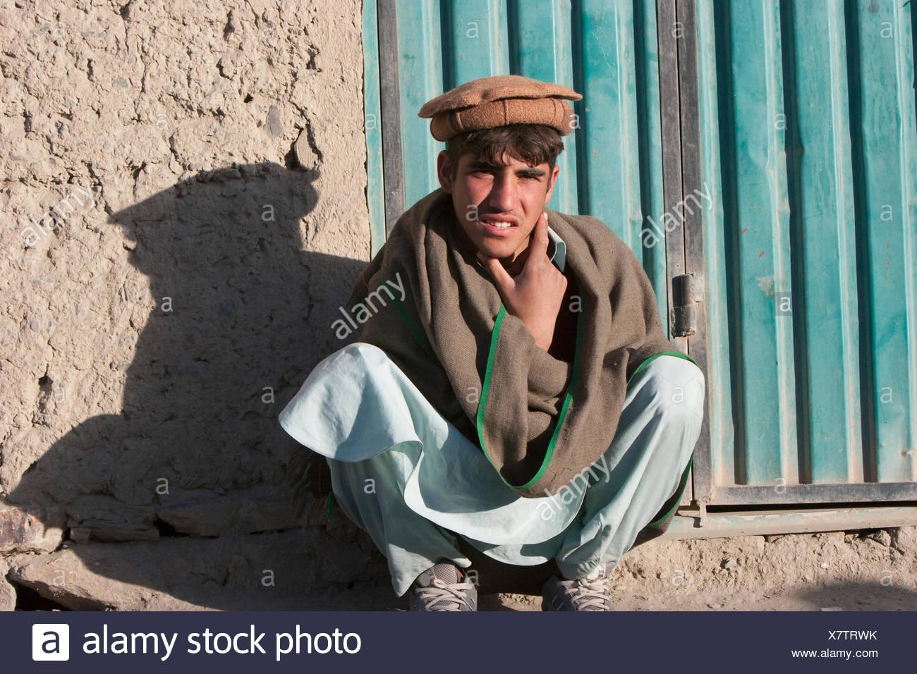 Afghan Men Watch A Cock