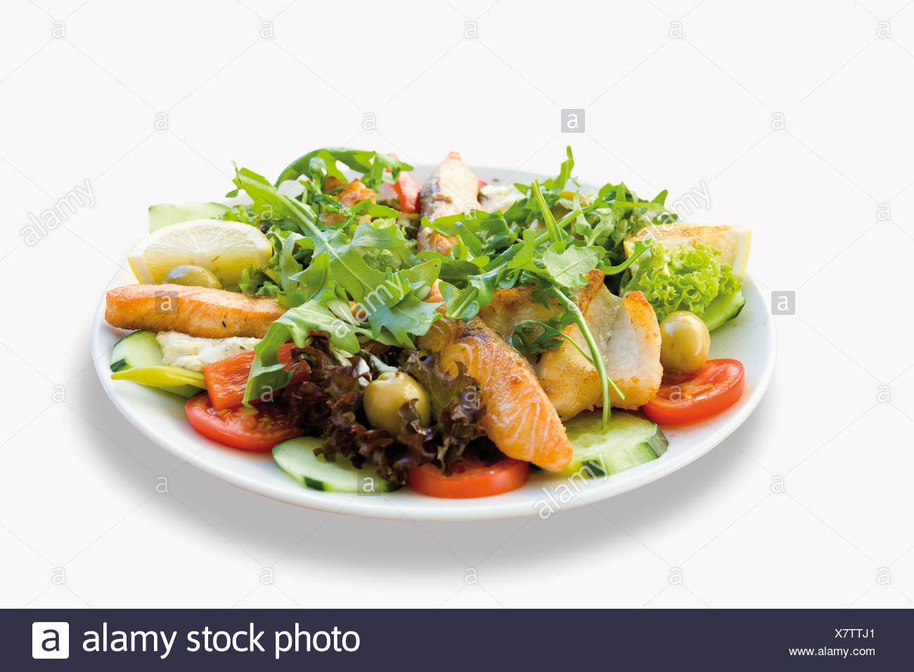 Fried fish salmon garnished with mixed salad and pike-perch in plate on white background - Stock Image