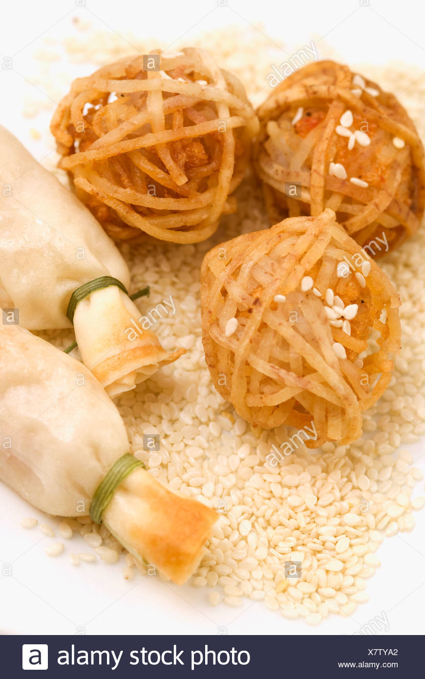 Shrimp balls wrapped in rice noodles and served with sushi - Stock Image