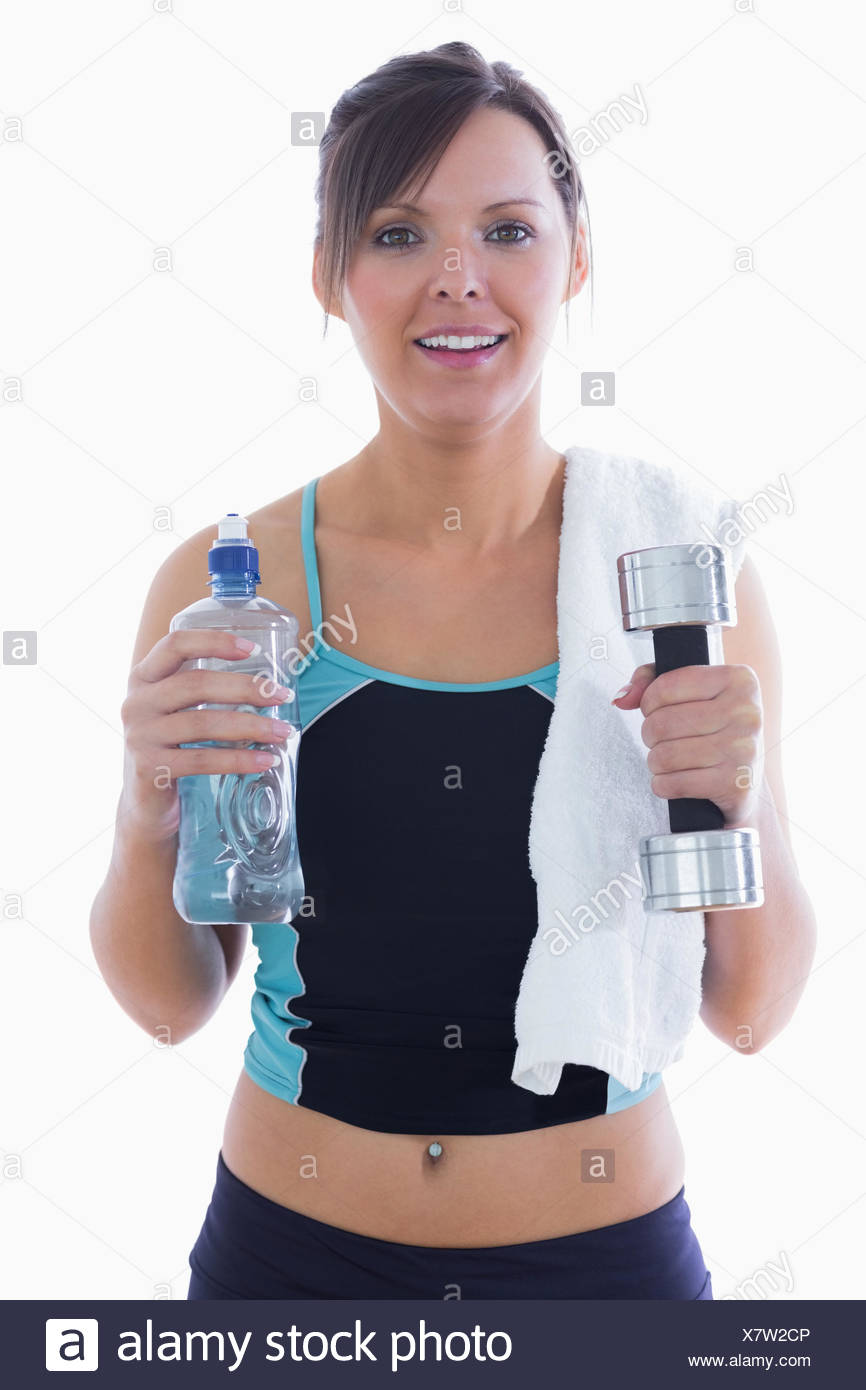 74307345b6 Portrait of woman holding dumbbell and water bottle Stock Photo ...