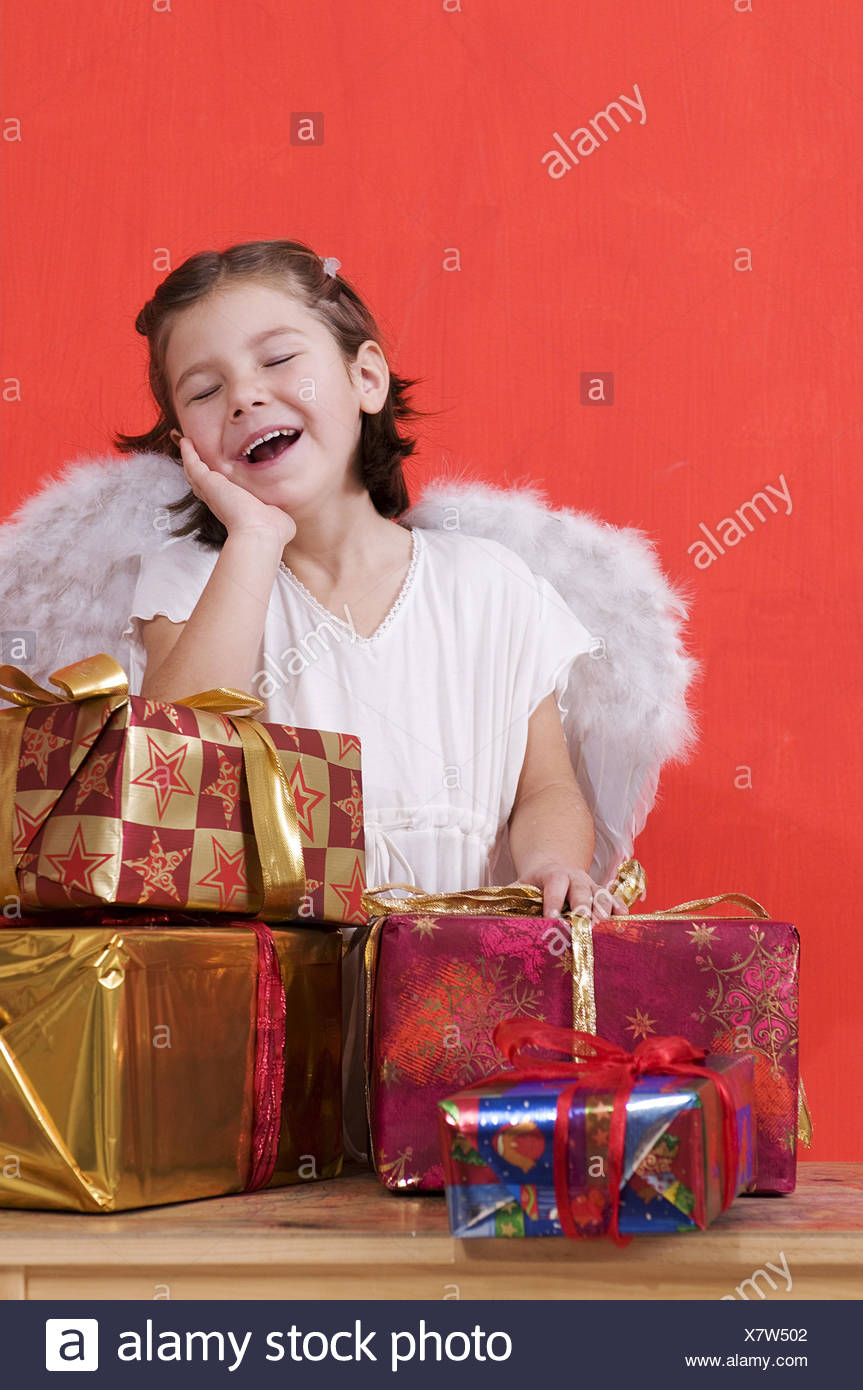Girls, angel's costume, presents, facial play, - Stock Image
