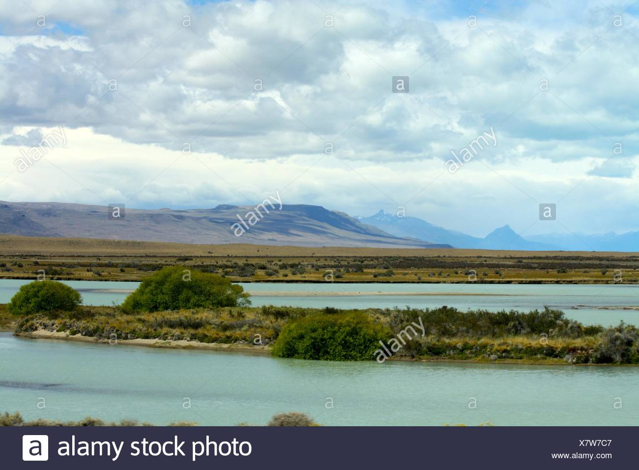 A Small Island On A Body Of Water - Stock Image