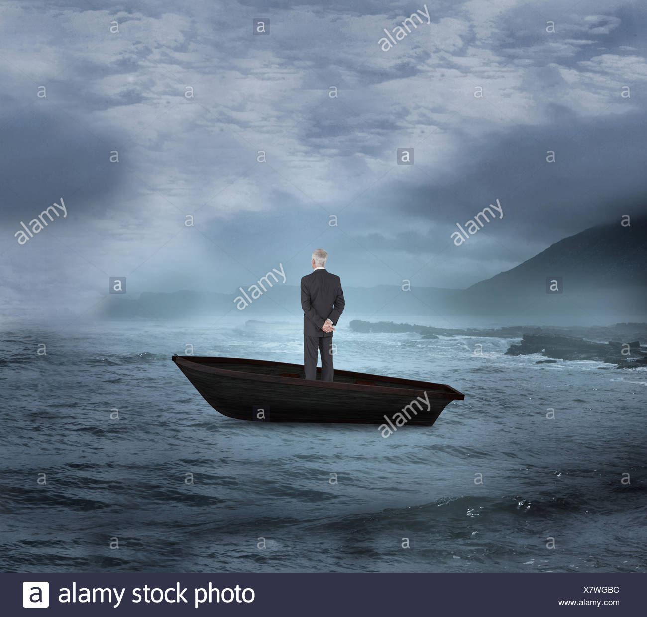 Composite image of rear view of mature businessman posing in a sailboat - Stock Image
