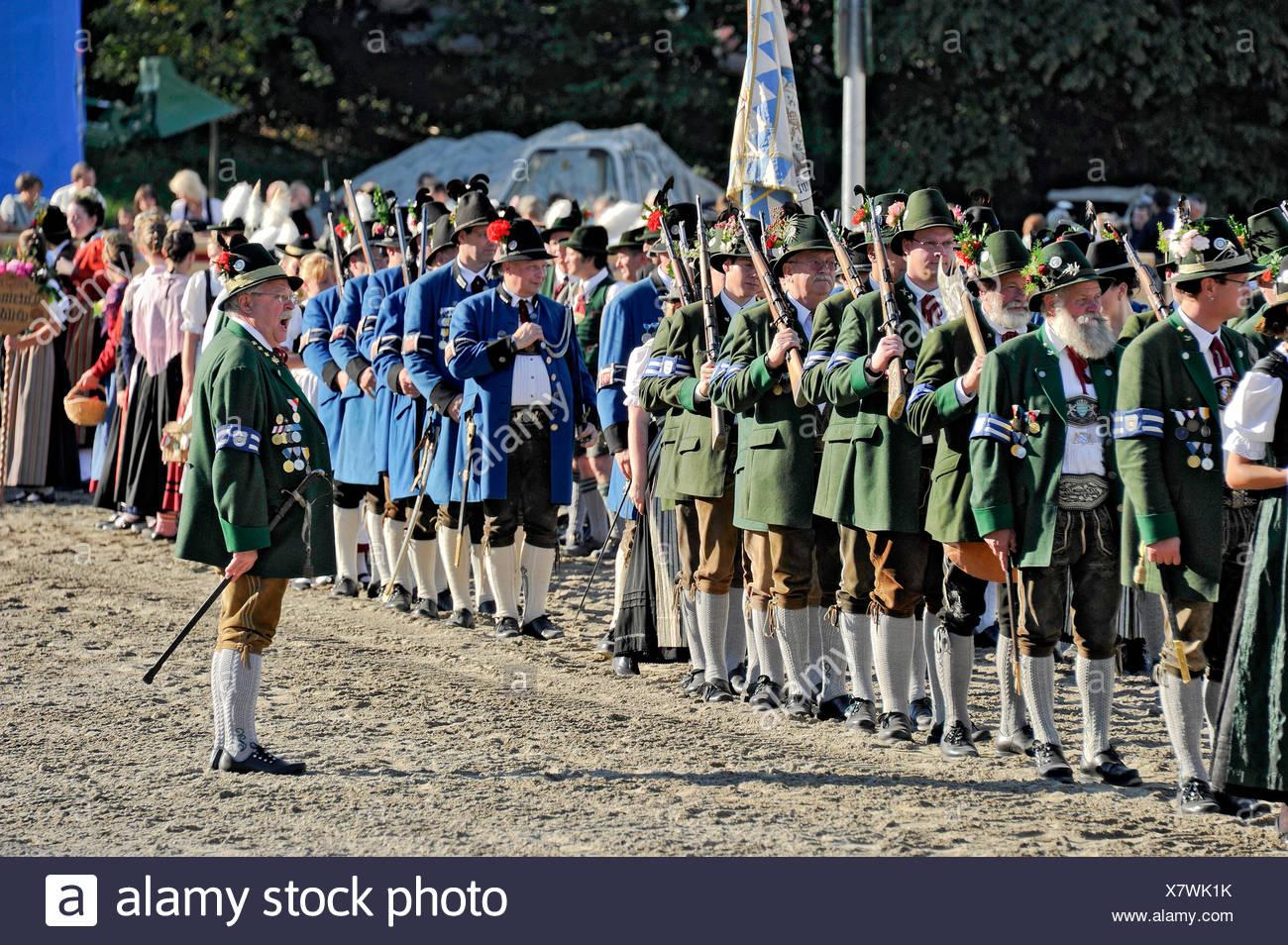 Parade of the gun clubs, members wearing traditional Bavarian costumes, fairground, Oktoberfest festival, Munich, Upper Bavaria - Stock Image