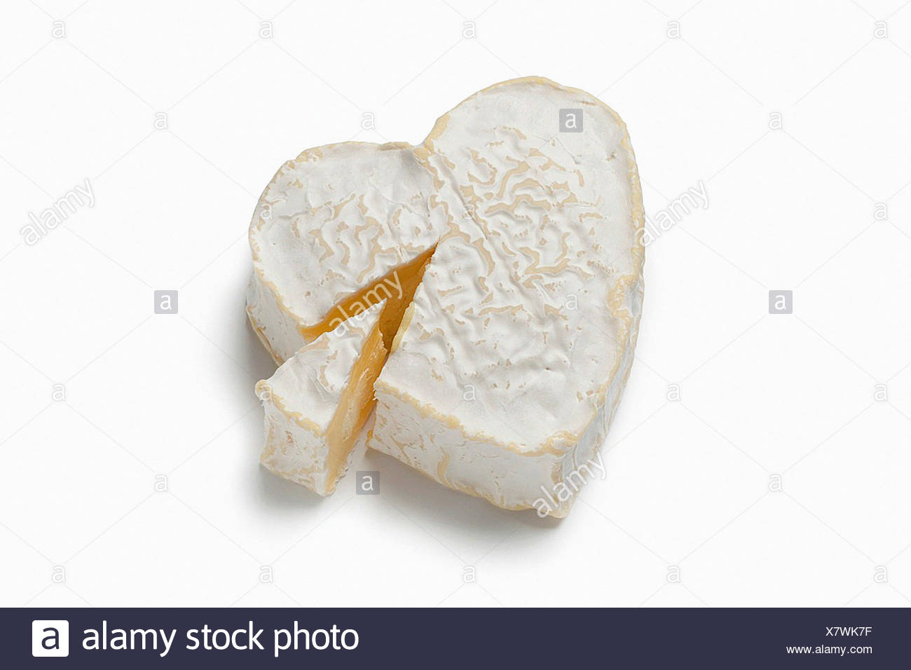 Heartshaped Neufchatel cheese on white background - Stock Image