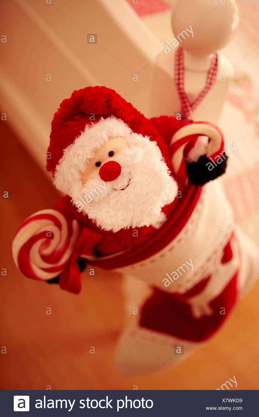 Close up of Christmas stocking hanging from bed - Stock Image