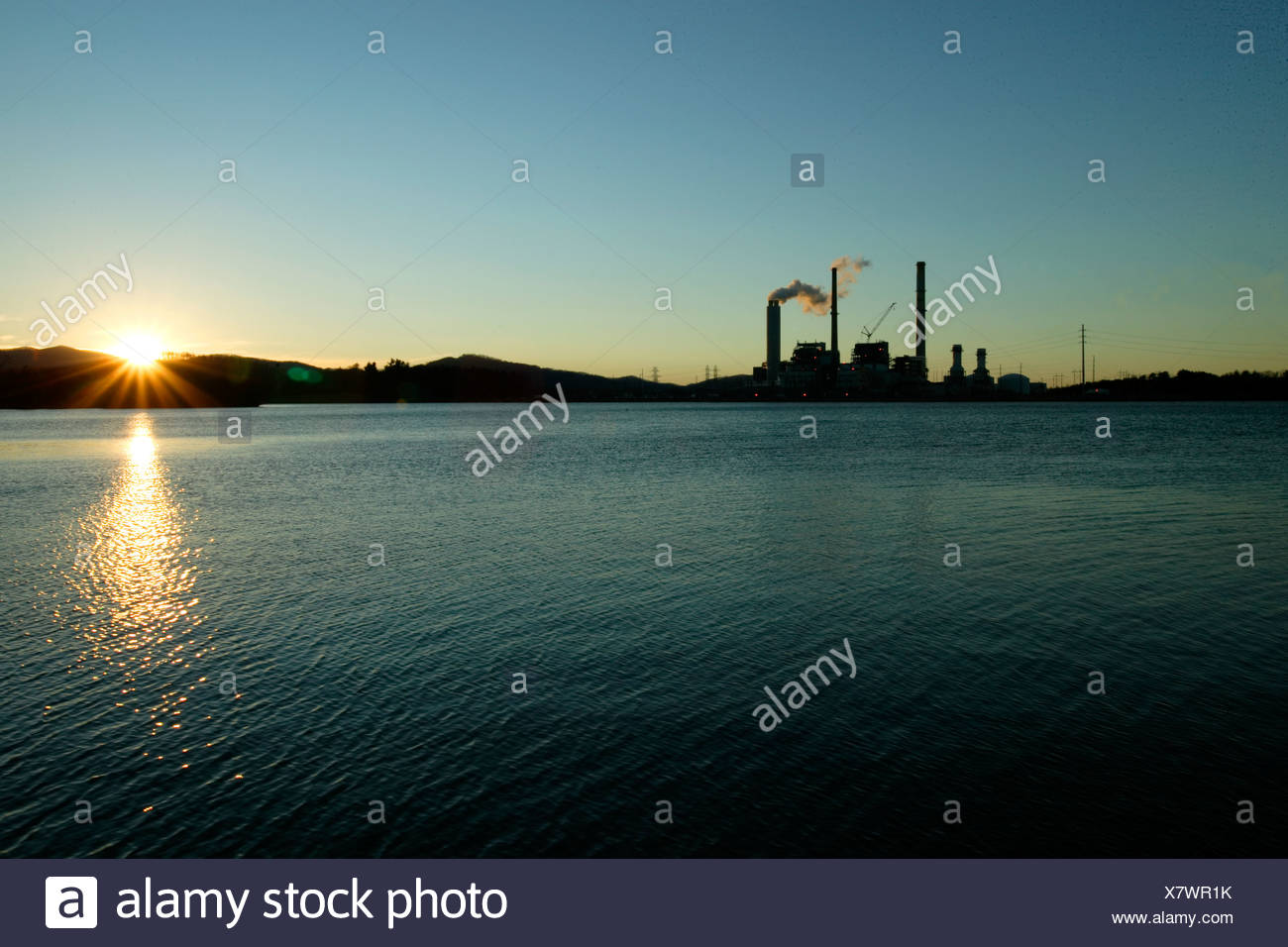 Sunset over Progress Energy's Lake Julian Power Plant and its new scrubber stack in South Asheville, NC. - Stock Image