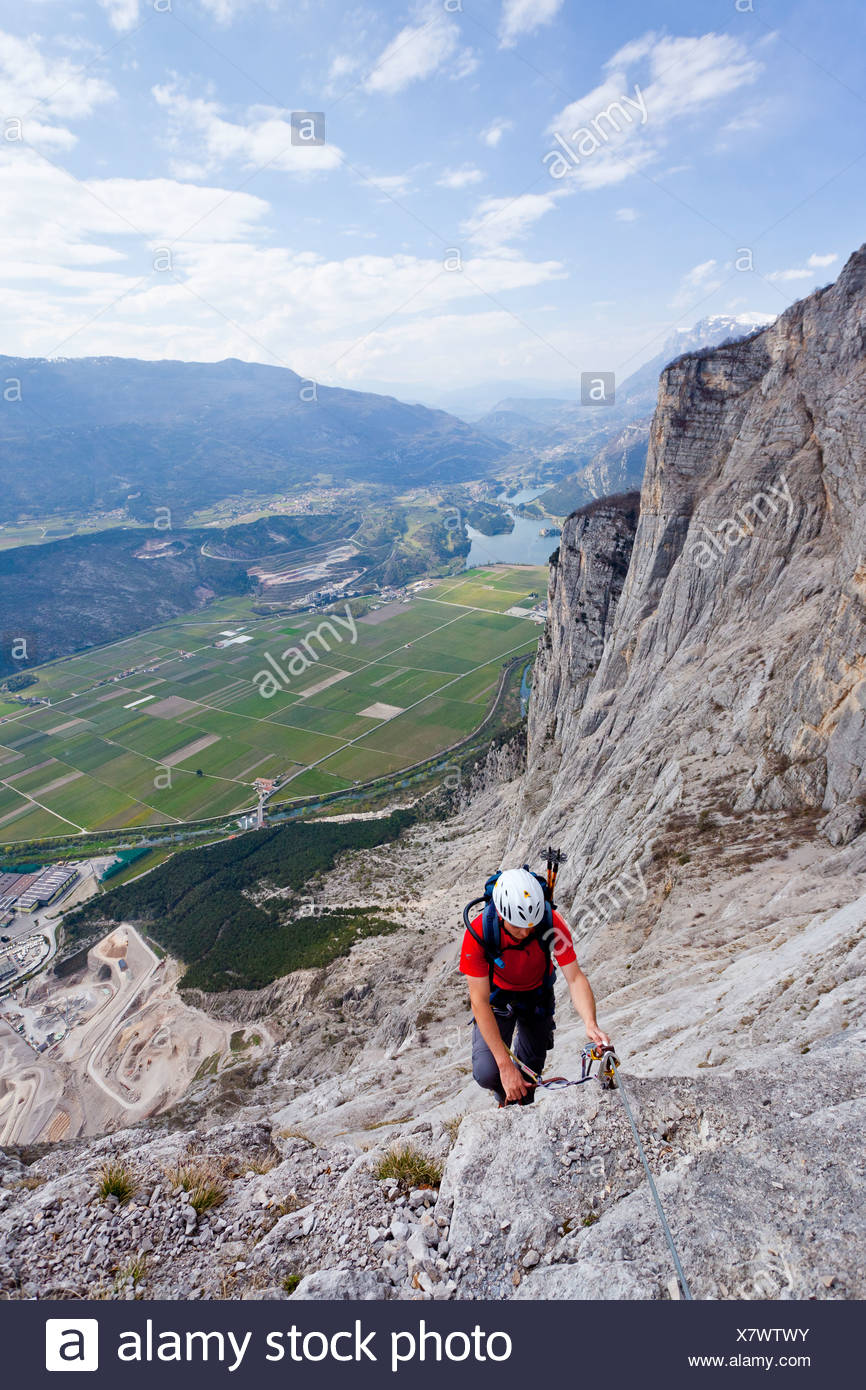 Climbers on the Che Guevara fixed rope route, Casale mountain in the Sarcatal valley, region of Lake Garda Stock Photo