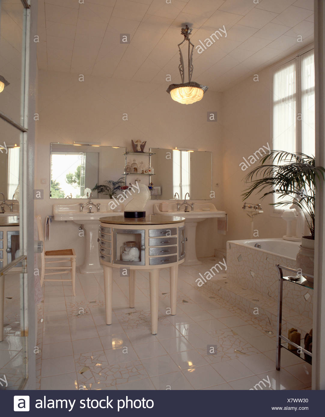 White Art Deco Bathroom With Chrome And White Circular Table And Mirror  Tiles In White Tiled Floor