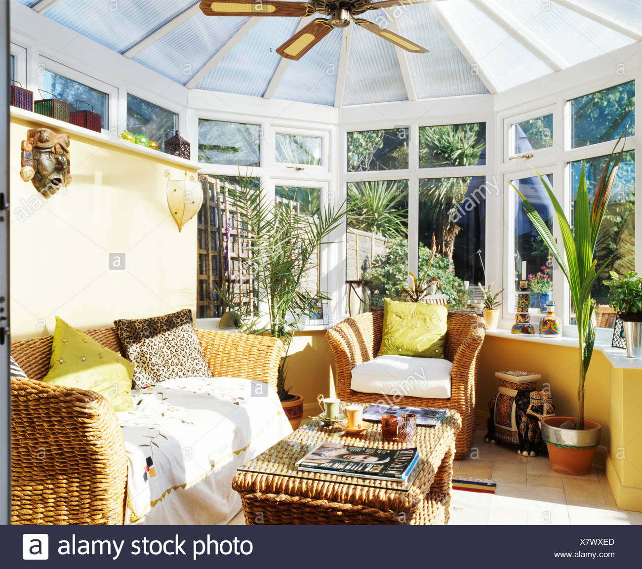 Lime Green Cushions On Wicker Sofa And Armchair In Conservatory Living Room Stock Photo Alamy