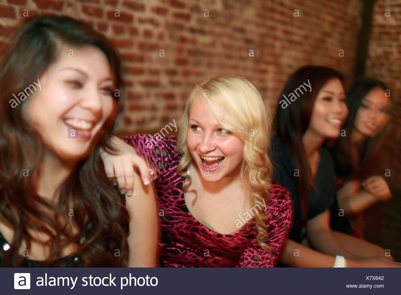 Teenage girls at a birthday party - Stock Image