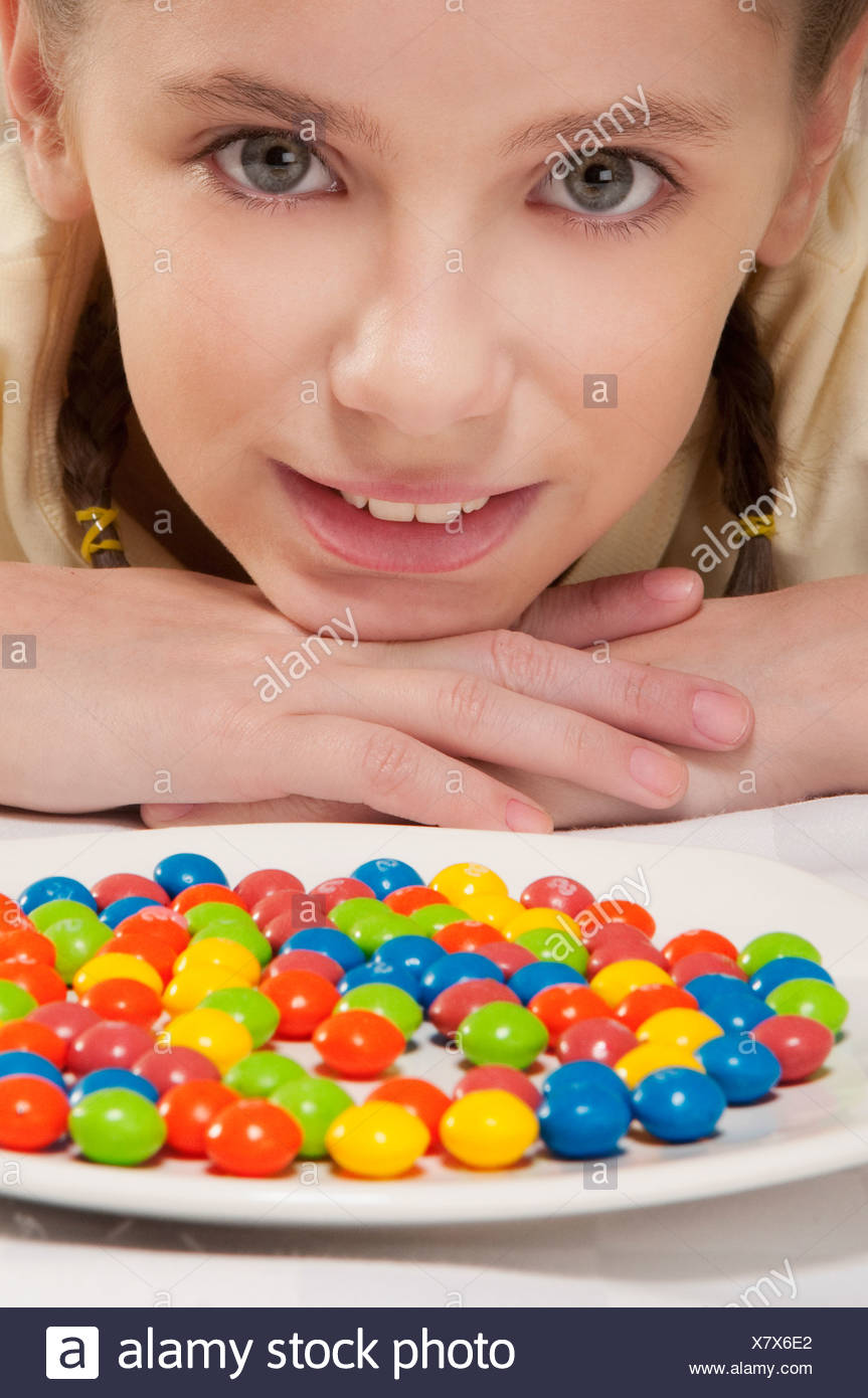 Portrait of a girl with a plate of candy Stock Photo