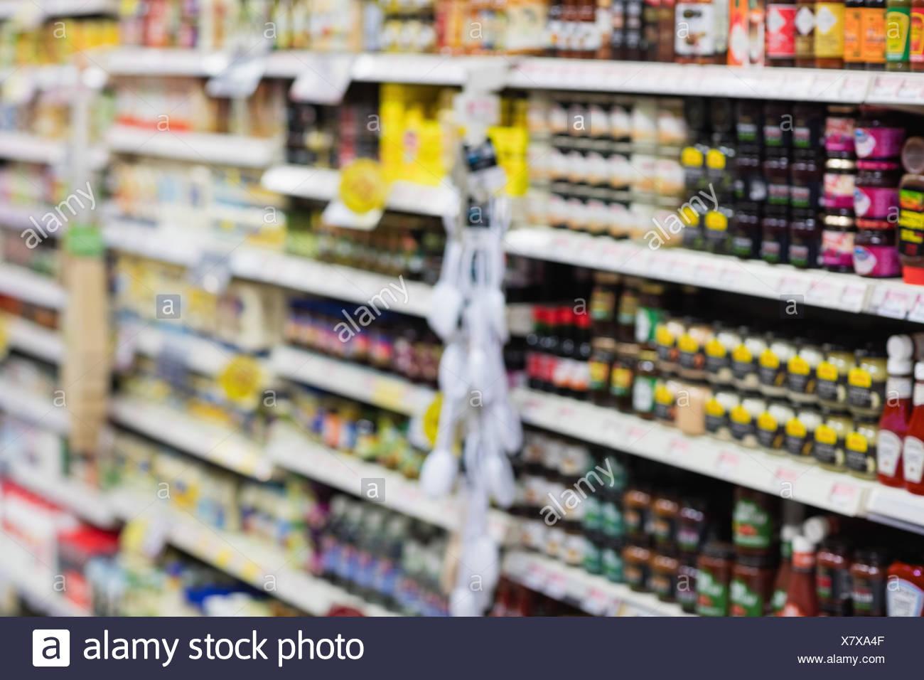 Side view of supermarket shelves - Stock Image