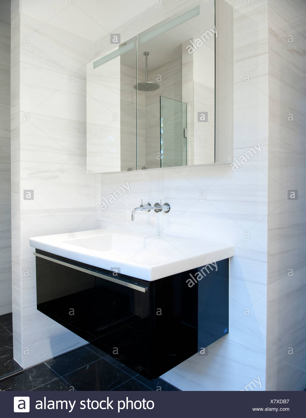 A bathroom sink and cabinet - Stock Image
