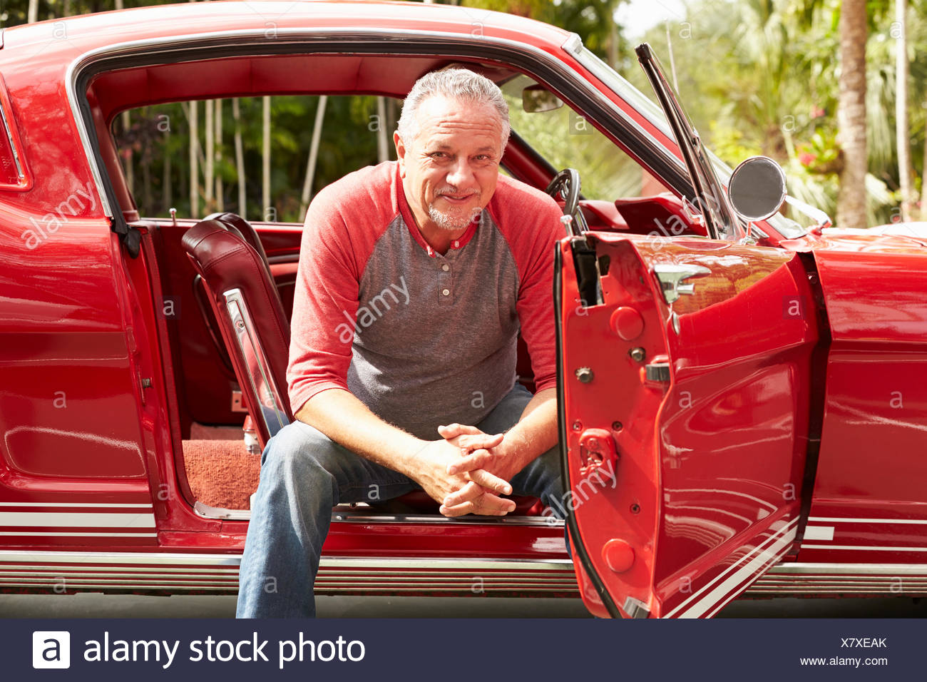 Retired Senior Man Sitting In Restored Classic Car Stock Photo