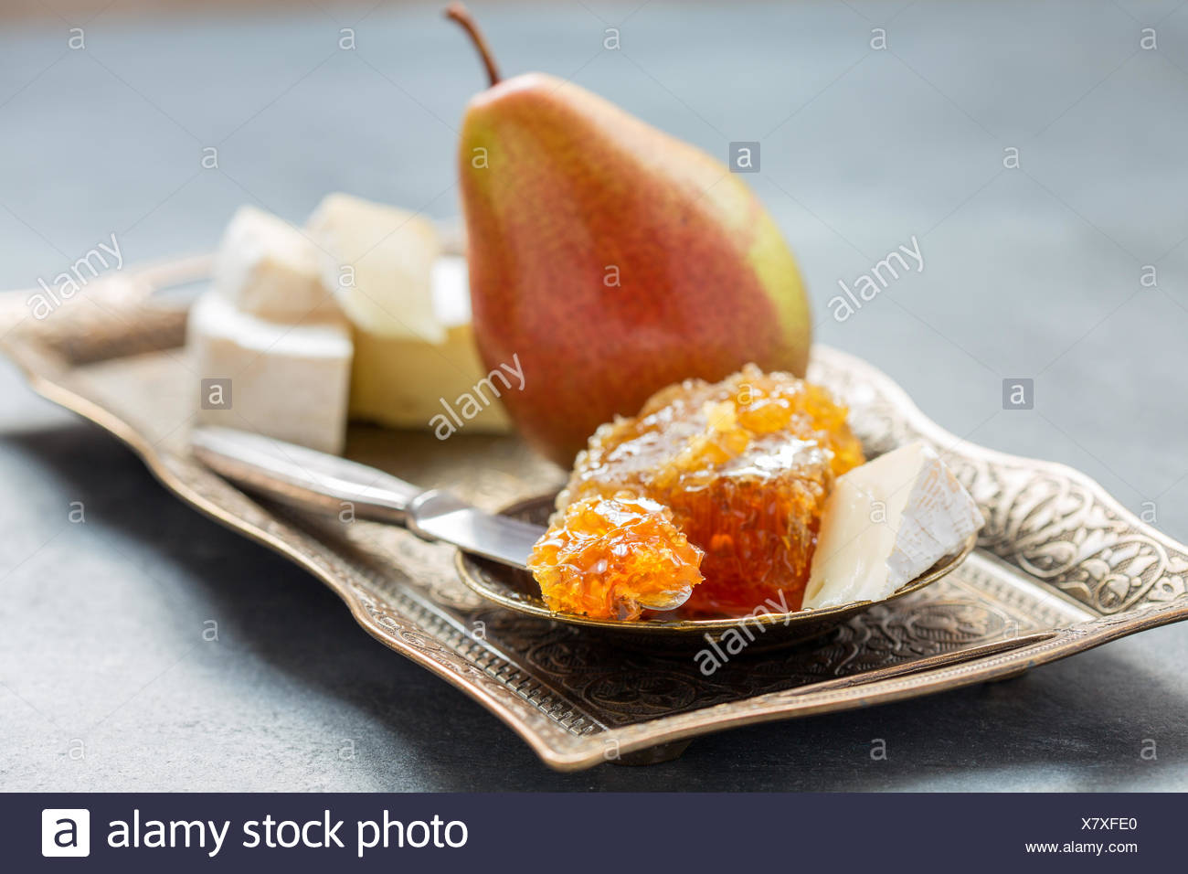 Honey, pear and brie cheese. - Stock Image