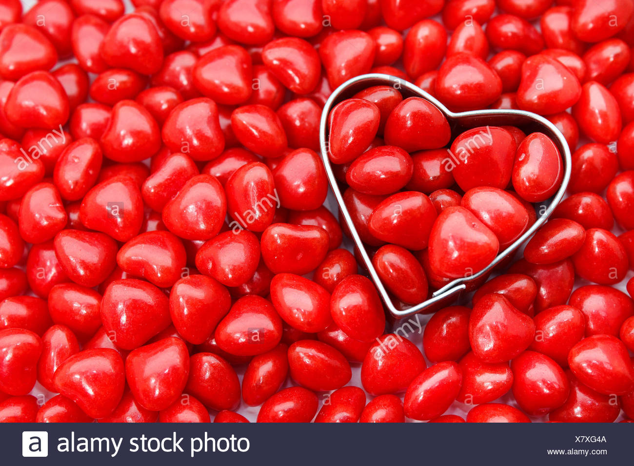 Directly Above Shot Of Pastry Cutter With Red Heart Shape Food - Stock Image