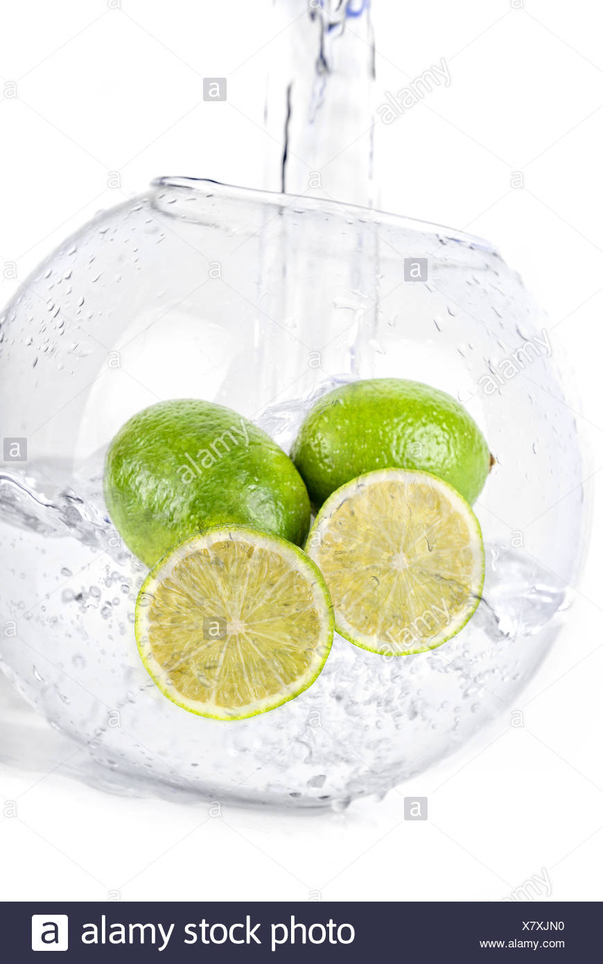 limes in water - Stock Image