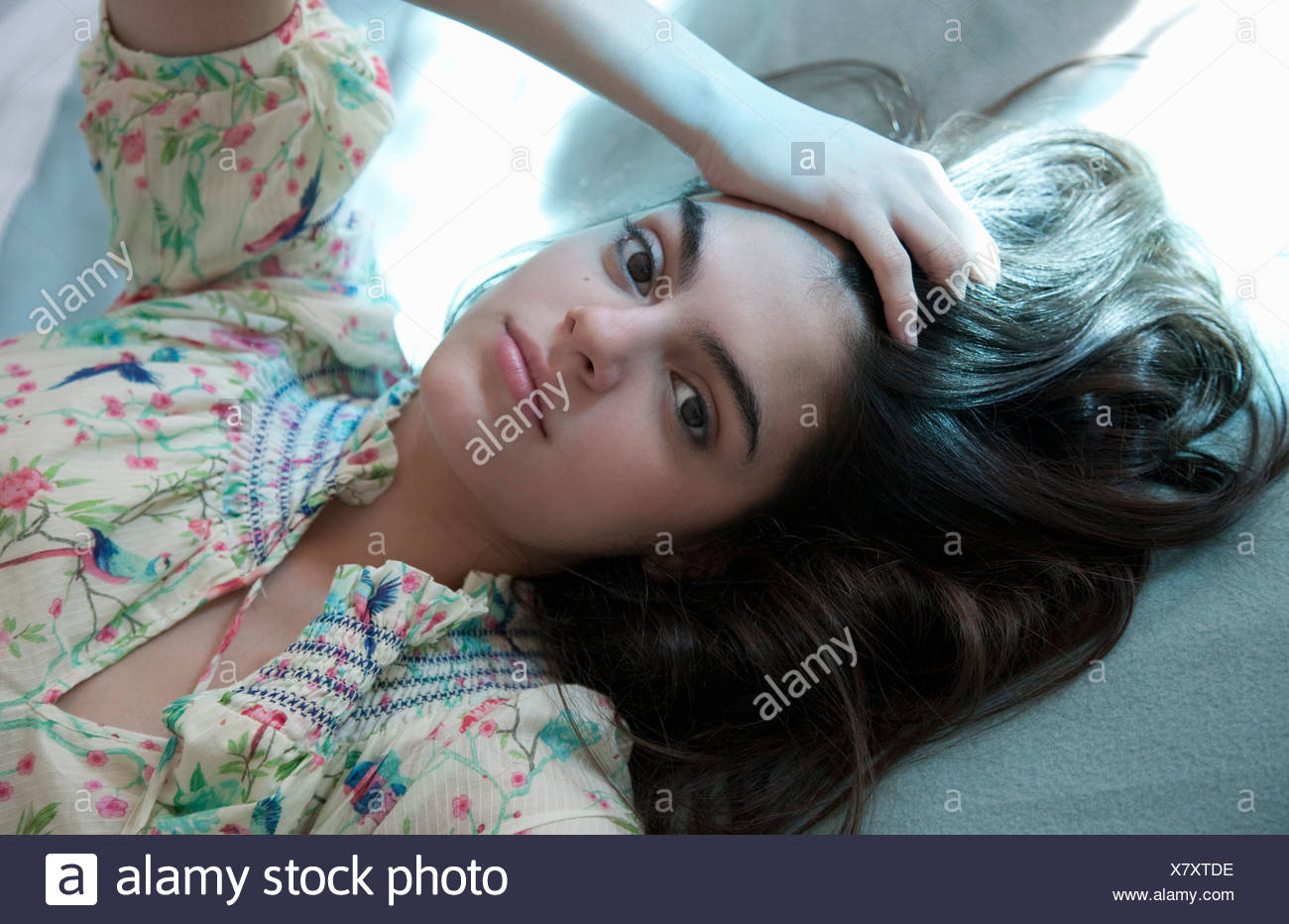 Portrait of young woman in summery dress - Stock Image