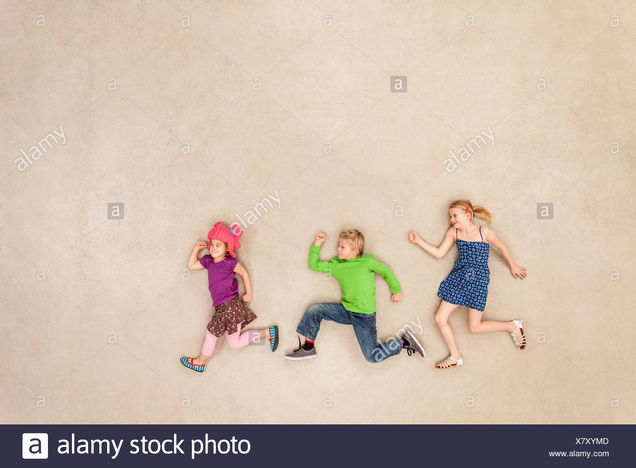 Children playing tag - Stock Image