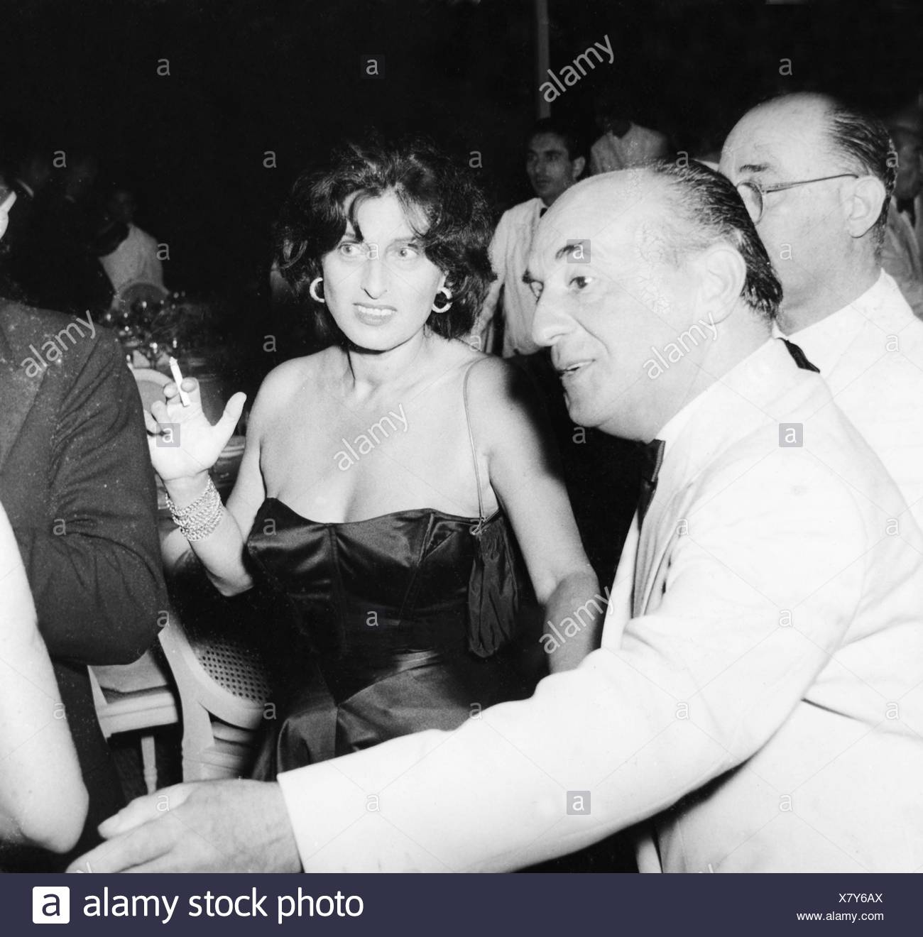Magnani, Anna, 7.3.1908 - 26.9.1973, Italian actress, half length, with Leonide Moguy, at celebration on the occasion of the premiere of her movie, 'The Awakening' (Suor Letizia), 1956, Additional-Rights-Clearances-NA - Stock Image
