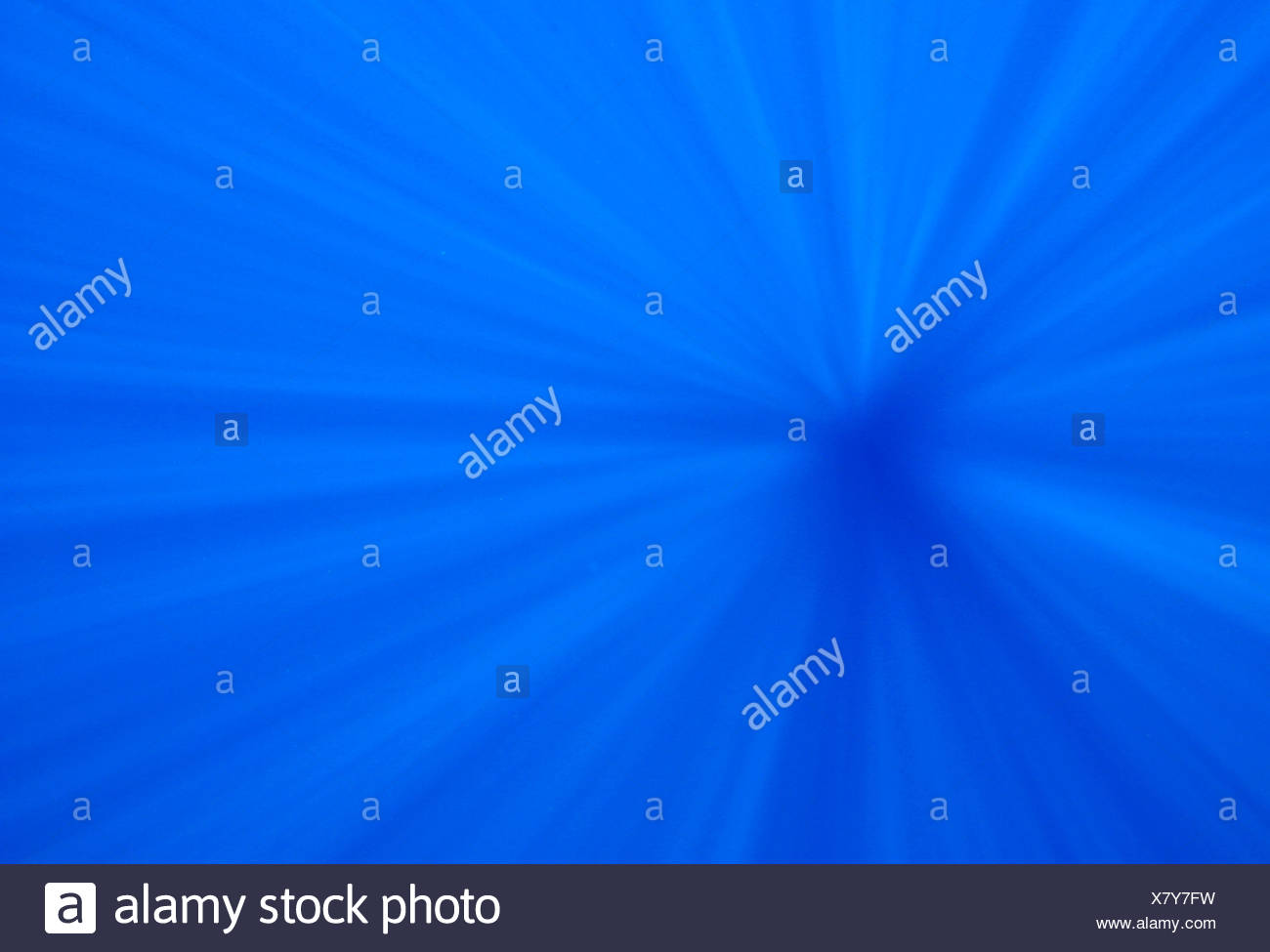 BLUE WATER AND GOD BEAMS OR SUN RAYS - Stock Image