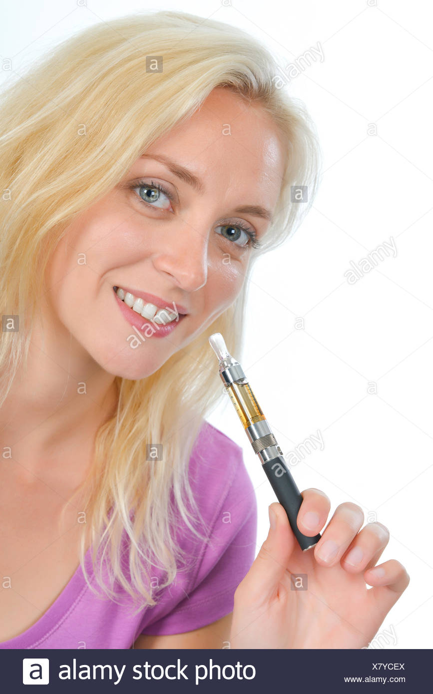 Woman trying an electronic cigarette - Stock Image