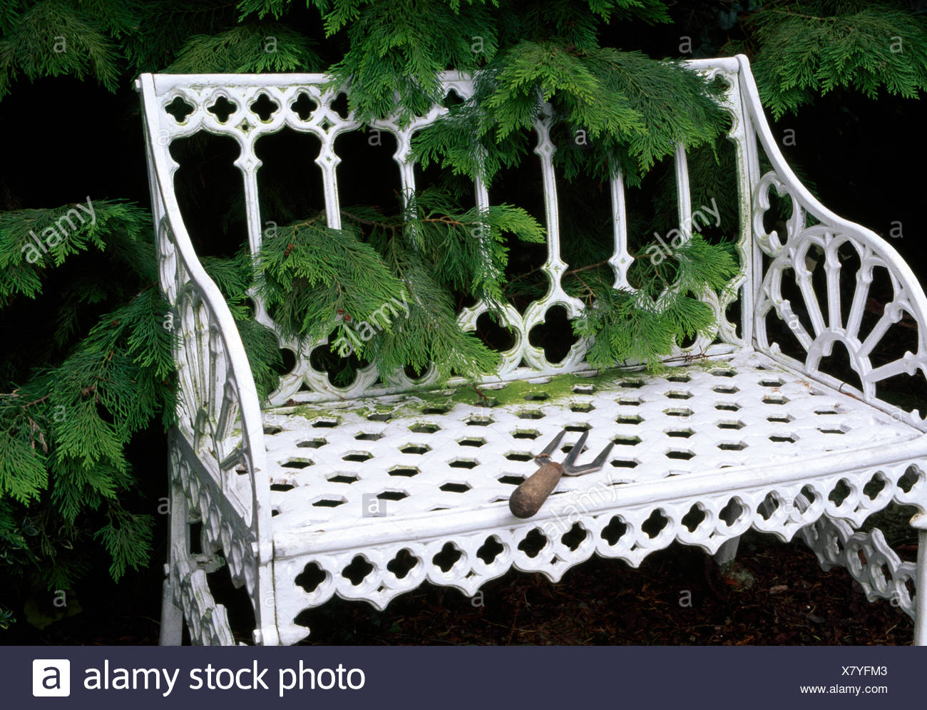 Phenomenal Small Garden Fork On A White Wrought Iron Garden Bench In Gamerscity Chair Design For Home Gamerscityorg