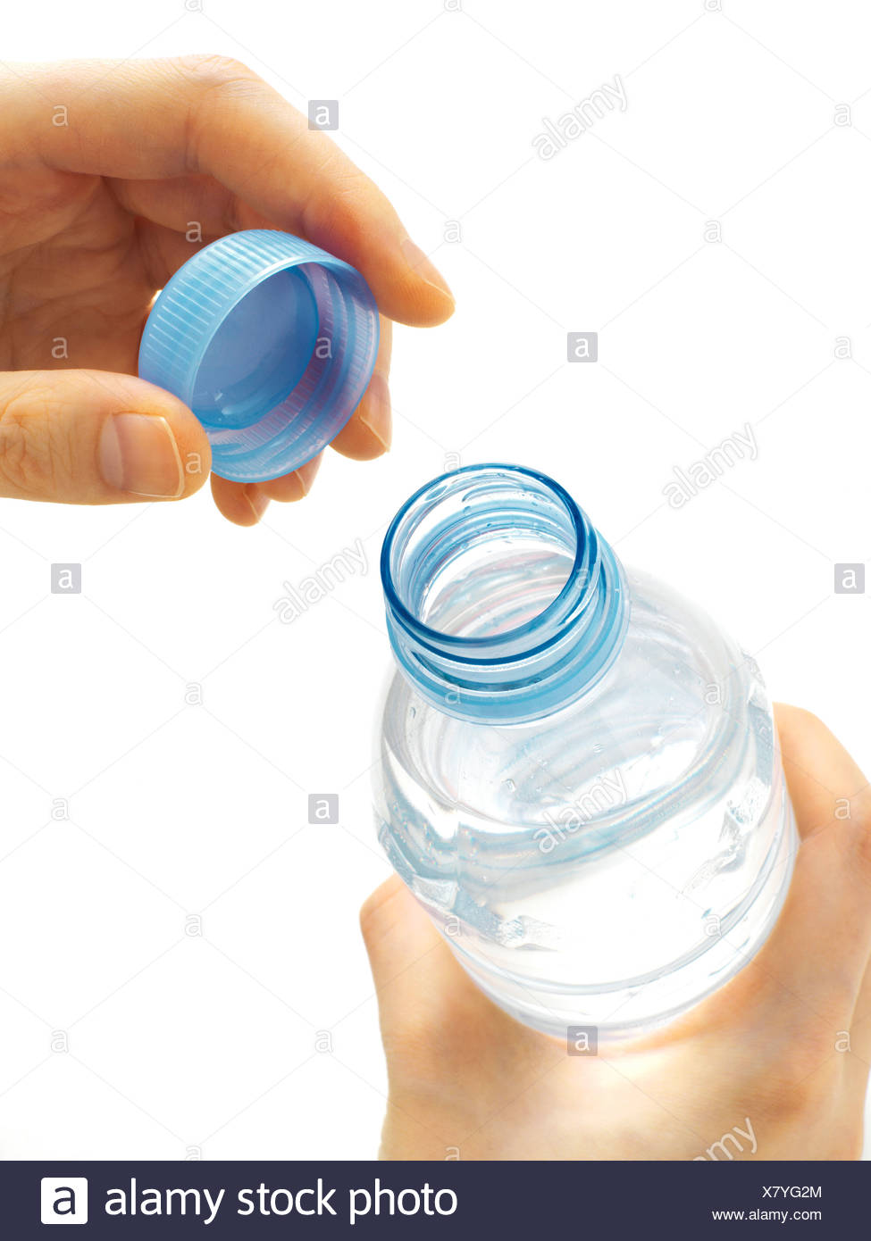 Female hand opening a water bottle - Stock Image