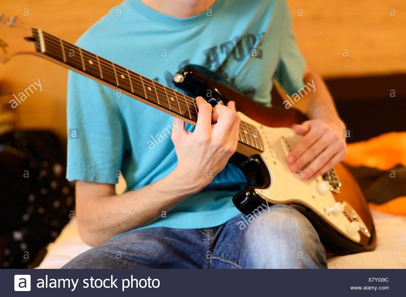 Teenage Boy Playing Electric Guitar On Bed Stock Photo 280273992