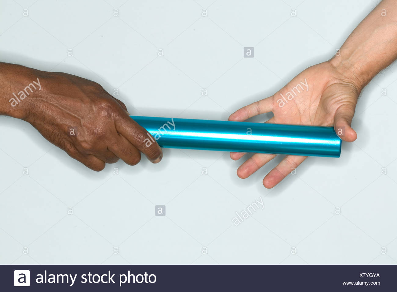 Passing baton from one hand to another - Stock Image