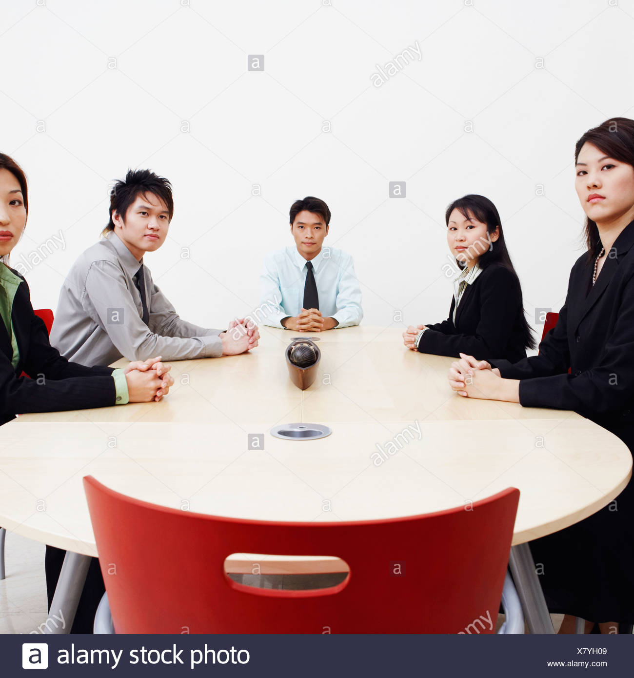 Portrait of business executives sitting in a board room Stock Photo