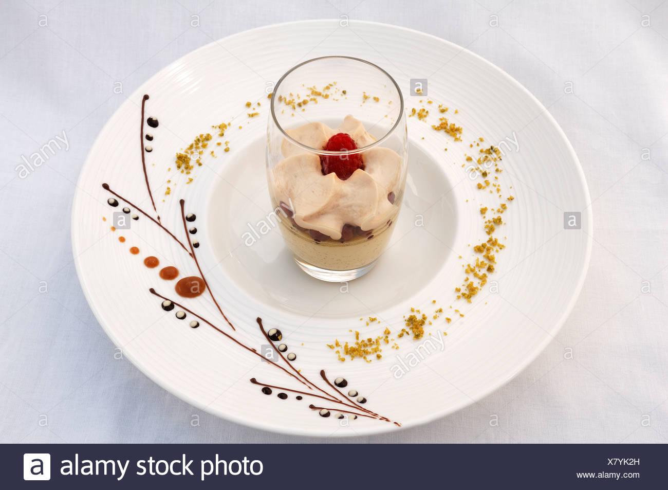 Dessert, latte macchiato mousse on a decorated plate, haute cuisine, Auberge de la Ferme Hueb, Mike Germershausen, Marckolsheim - Stock Image
