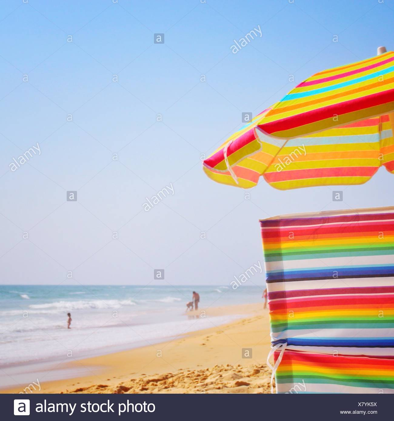 Multi Colored Umbrella On Beach Against Clear Sky - Stock Image