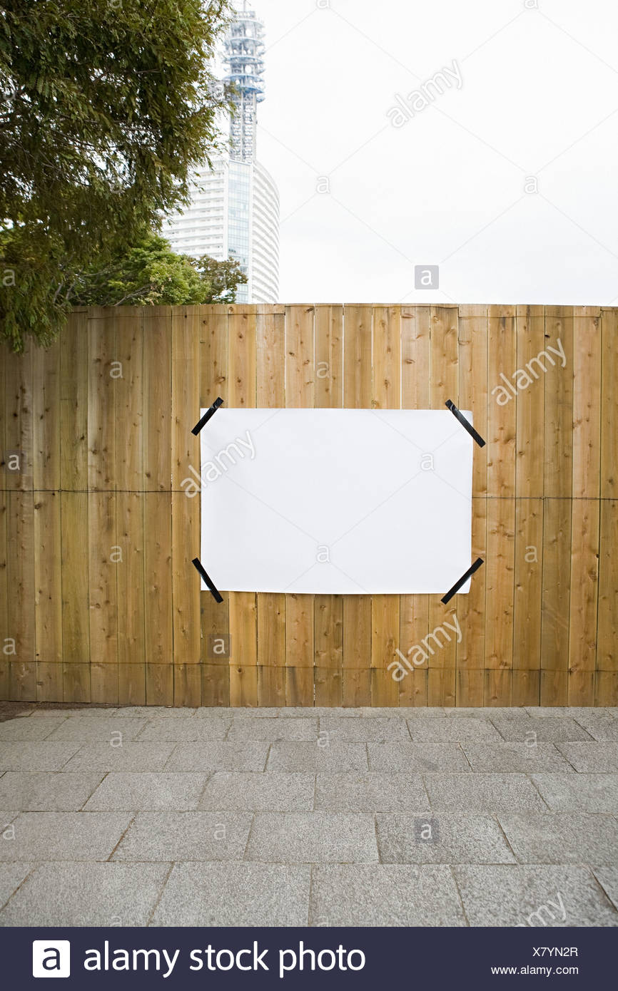 Paper on a fence - Stock Image