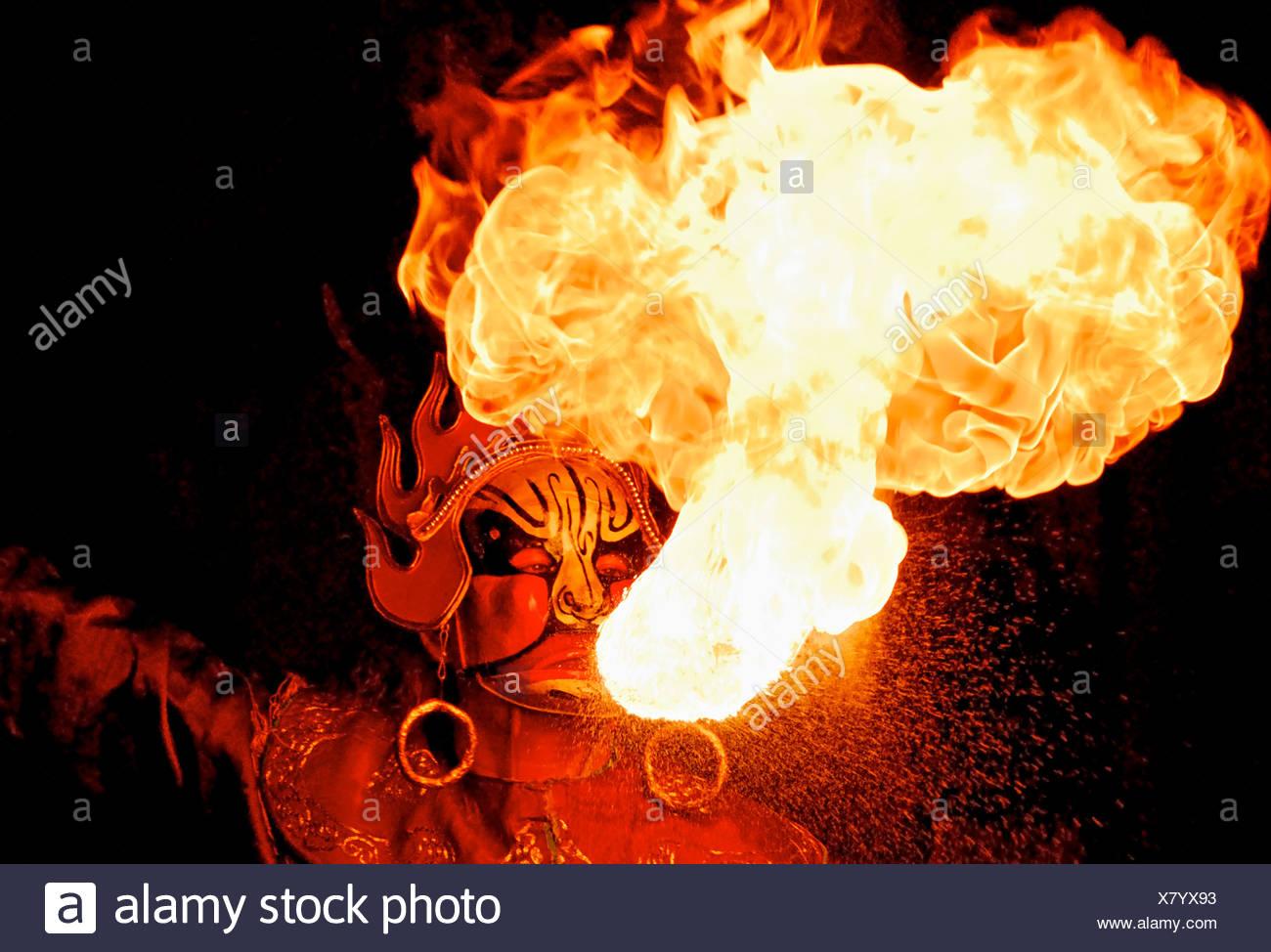 Fire spitter at Sichuan Opera Chengdu China - Stock Image