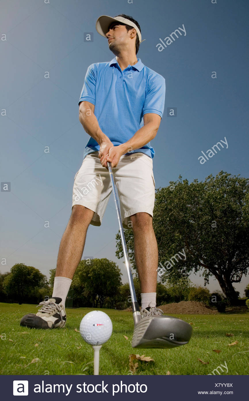 Golfer about to tee off - Stock Image