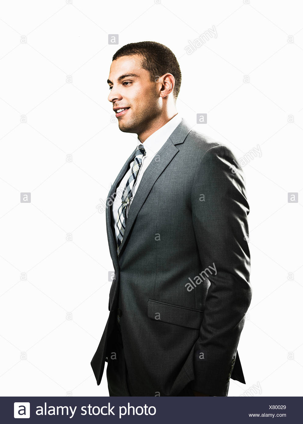 Businessman with hands in pockets - Stock Image