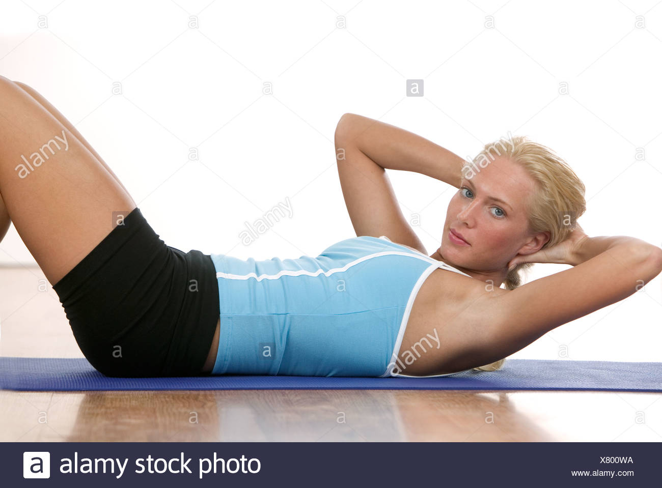 A young woman working out - Stock Image