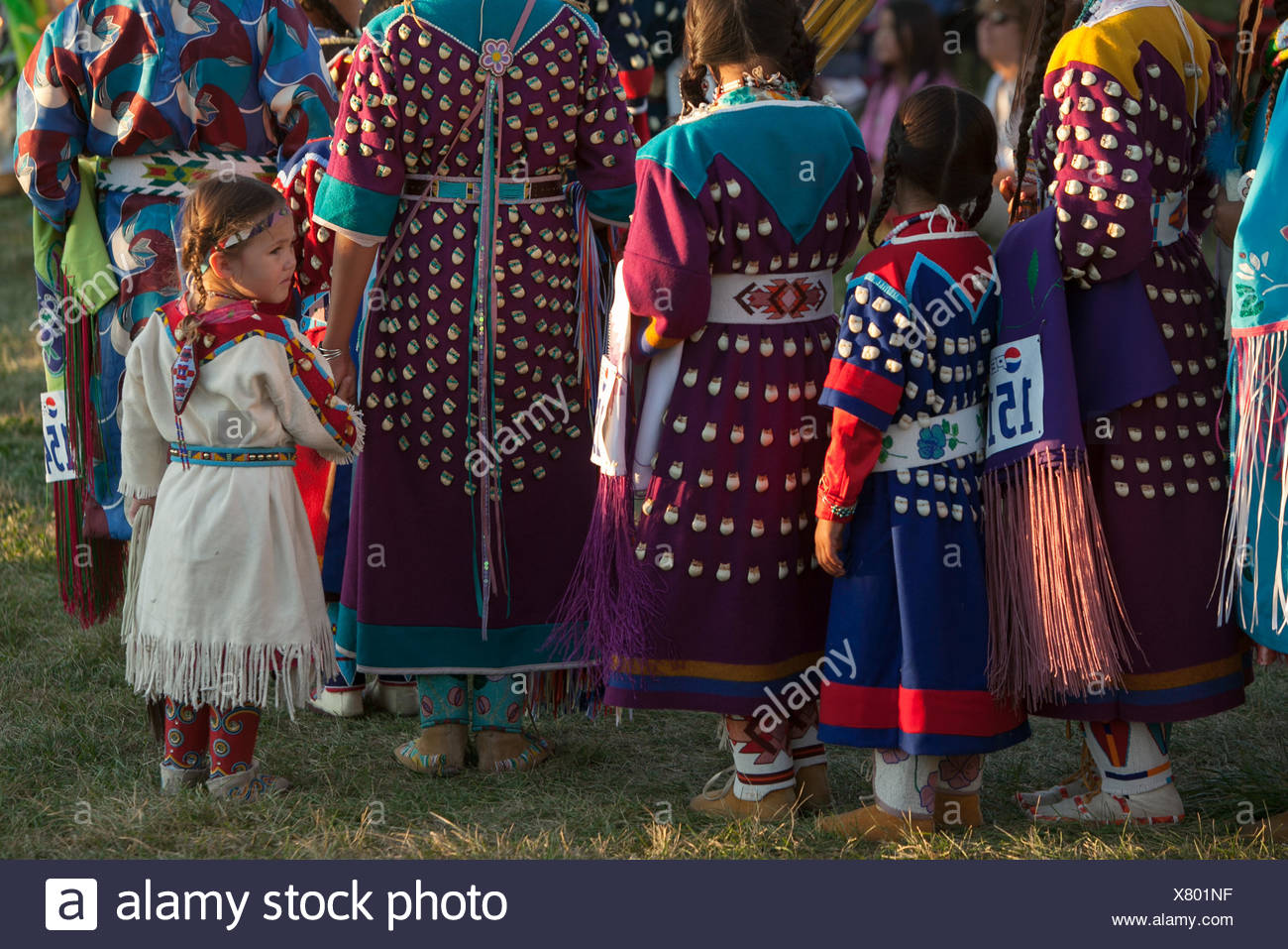 Girls and women wear traditional regalia for the annual pow wow at the Crow Indian Reservation. - Stock Image