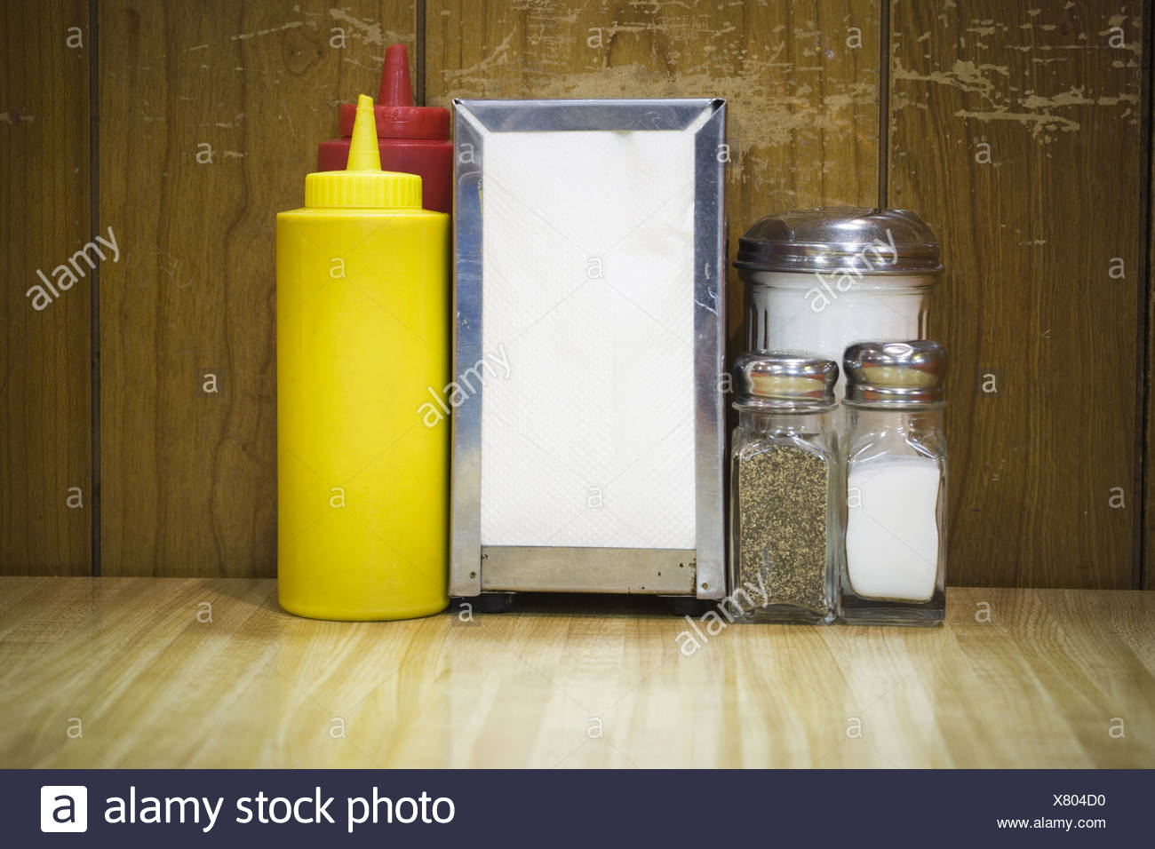 Pepper Shaker And Salt Shaker With A Napkin Holder On A Table In A Restaurant Stock Photo Alamy