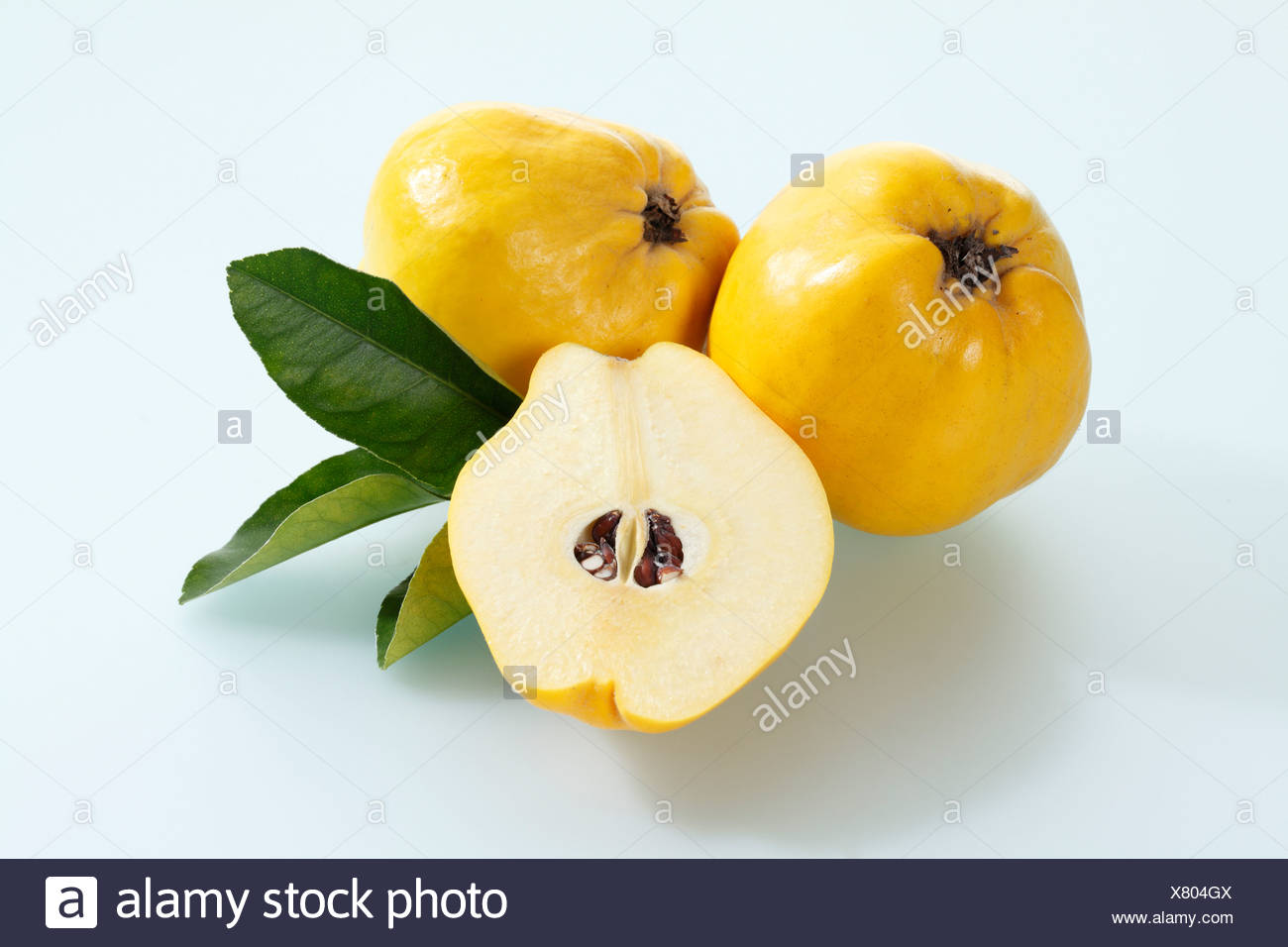 Quinces on white background, close up Stock Photo