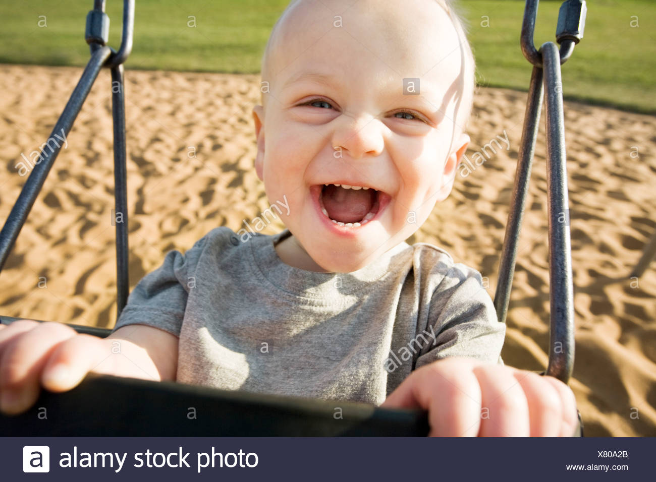 Boy in a swing Stock Photo