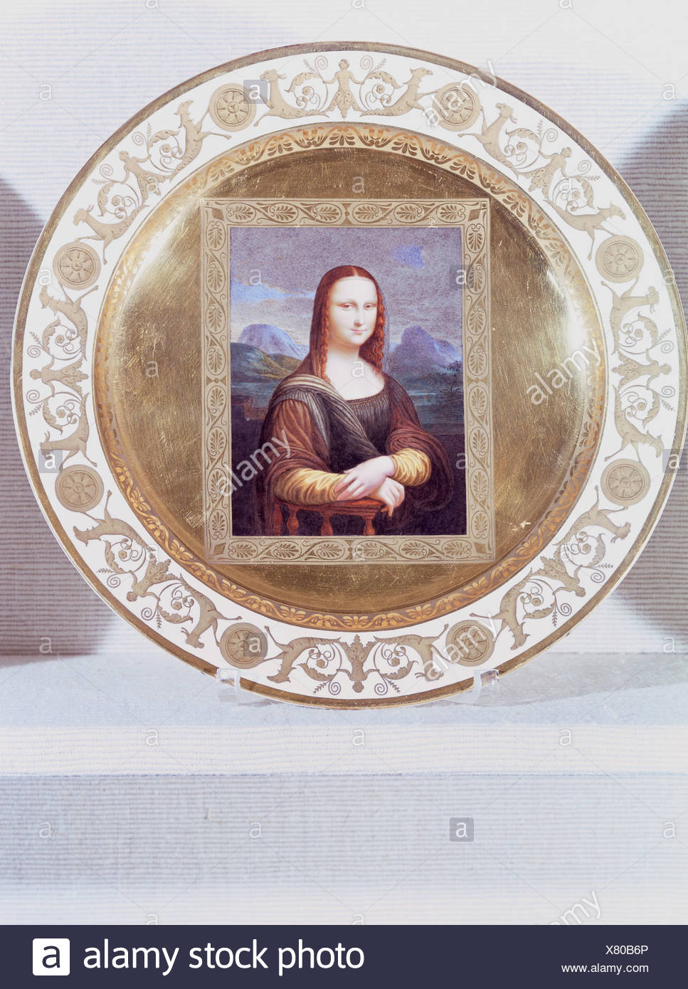 "fine arts, porcelain, plate, series with gold plating, ""Mona Lisa"", based on Leonardo da Vinci (1452 - 1519), Nymphenburg Porcelain Manufactory, Germany, early 19th century, Munich Residence, porcelain collection, Artist's Copyright has not to be cleared Stock Photo"