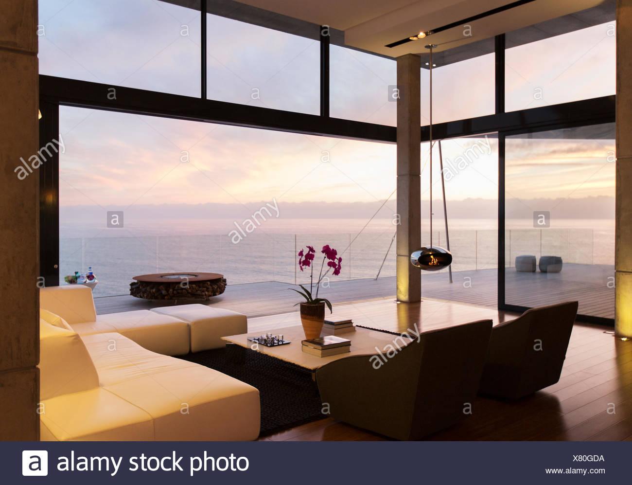 Modern living room overlooking ocean Stock Photo