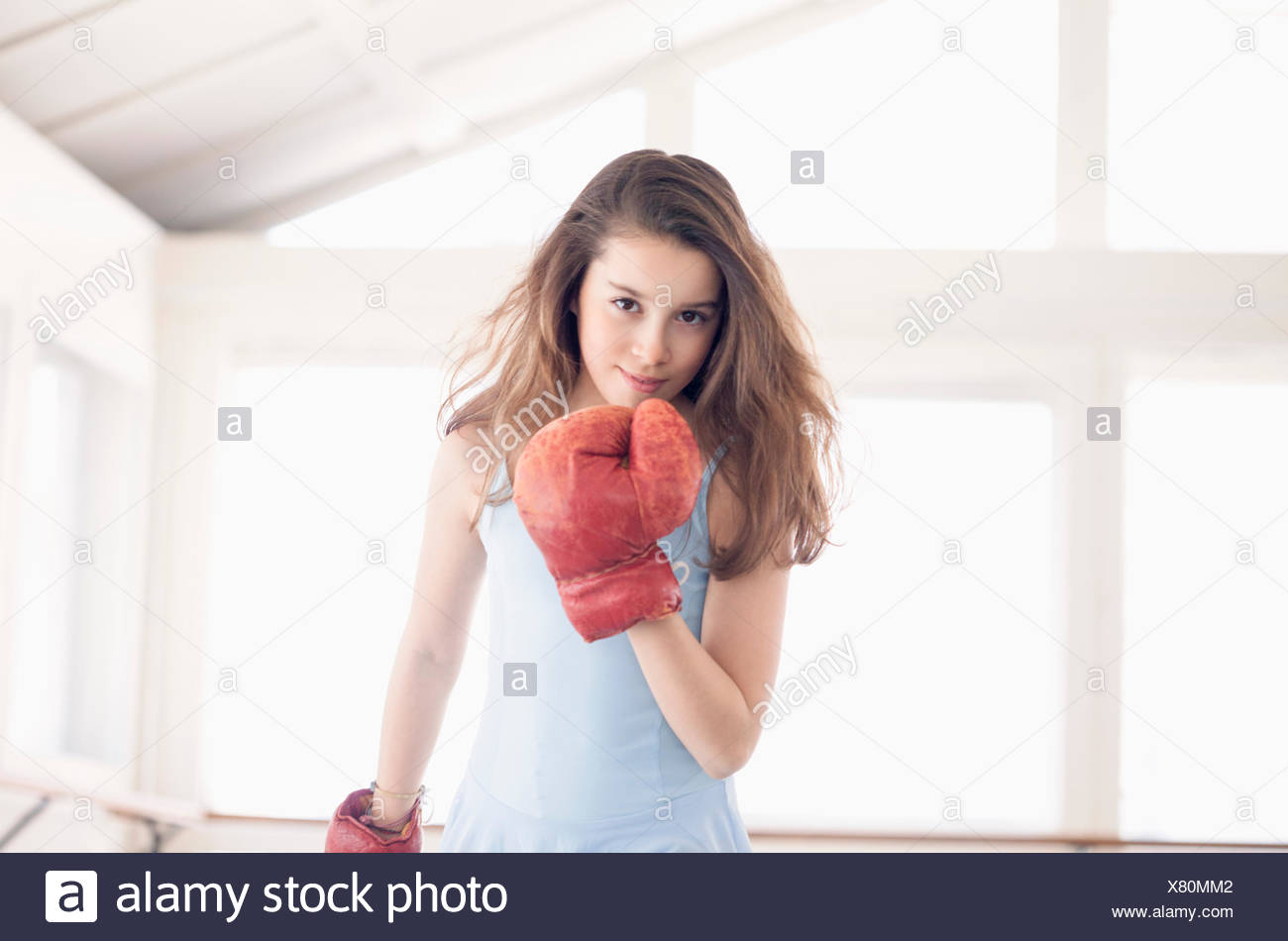 Girl with boxing glove - Stock Image