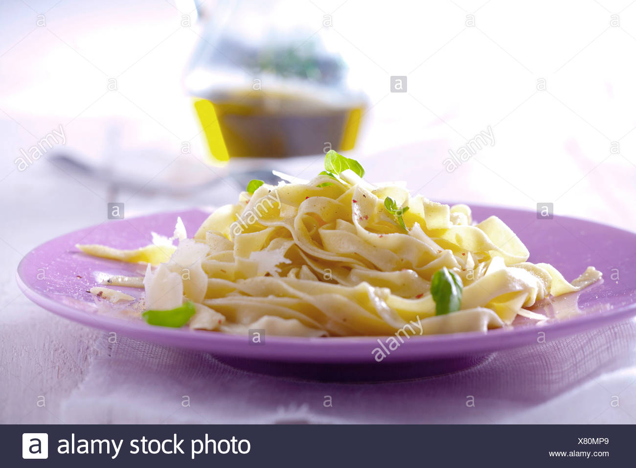 Ribbon pasta with olive oil, parmesan and basil - Stock Image